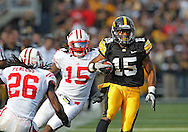 October 23 2010: Iowa Hawkeyes wide receiver Derrell Johnson-Koulianos (15) runs after a catch during the first half of the NCAA football game between the Wisconsin Badgers and the Iowa Hawkeyes at Kinnick Stadium in Iowa City, Iowa on Saturday October 23, 2010. Wisconsin defeated Iowa 31-30.