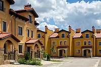 "Townhouses real estate in ""Italian Village"" residential development project in Kyiv, Ukraine. Exterior view with the daylight and cloudy sky."
