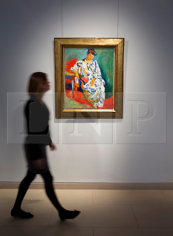 © Licensed to London News Pictures. 04/04/2013. London, UK. A Christie's employee views 'Madame Matisse au kimono' (est. US$15,000,000-20,000,000), an oil painting of the wife of artist Henri Matisse painted by Andre Derain in 1905, at an auction press preview in St James, London today (04/04/2013). The auction, consisting of Impressionist & Modern Art, is set to take place  on the 8th of May in Christie's New York auction house.  Photo credit: Matt Cetti-Roberts/LNP