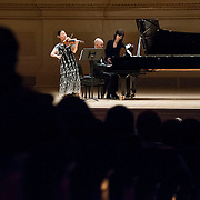 November 7, 2012 - New York, NY : Violinist Midori, left, and pianist Özgür Aydin perform in the Stern Auditorium / Perelman Stage at Carnegie Hall on Wednesday night. At far right is Tomoko Kawamukai, the page-turner. CREDIT: Karsten Moran for The New York Times