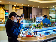 09 NOVEMBER 2018 - BANGKOK, THAILAND: Workers in a camera shop set up Sony cameras in ICONSIAM during the grand opening. ICONSIAM opened November 9. ICONSIAM is a mixed-use development on the Thonburi side of the Chao Phraya River. It includes two large malls, with more than 520,000 square meters of retail space, an amusement park, two residential towers and a riverside park. It is the first large scale high end development on the Thonburi side of the river and will feature the first Apple Store in Thailand and the first Takashimaya department store in Thailand.    PHOTO BY JACK KURTZ