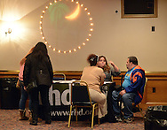 BRISTOL, PA -  OCTOBER 20: Seated from left, Emily Lennon helps Albert Rodriguez and his girlfriend Kim Stiltner, both of Bristol, Pennsylvania sign up for the Affordable Healthcare Act October 20, 2013 in Bristol, Pennsylvania. Representatives of Resource of Human Development made a presentation and answered questions about the Affordable Healthcare Act and helped sign people into the program for health insurance. (Photo by William Thomas Cain/Cain Images)