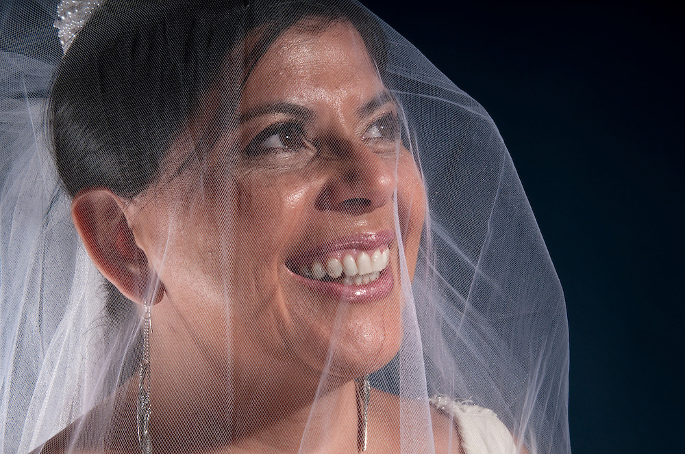 Latin woman in his 40 getting ready to be married, very happy.