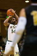 San Francisco Dons guard Charles Minlend (14) shoots a jumper against the San Francisco State University Gators at Kezar Pavilion in San Francisco, Calif., on December 6, 2016. (Stan Olszewski/Special to S.F. Examiner)