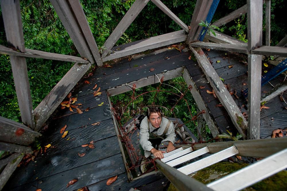 Roger Munns climbing up viewing tower,  Maliau Basin Study Centre, Maliau, Sabah, Borneo, East Malaysia.
