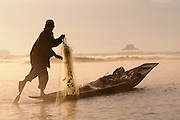 Early morning shot of the traditional fisherman in their rowing canues while fishing, Inle lake, Myanmar,Asia