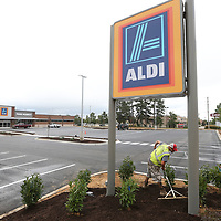 Sportsman Lawn and Landscape employee Chase Lowe begins to spread out mulch to complete the landscaping around the new Aldi grocery store on North Gloster in Tupelo.