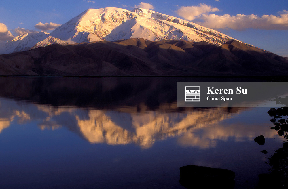 Landscape of Lake Karakuli with snow-capped Mt. Kunlun, Pamir Plateau, Xinjiang Province, Silk Road, China