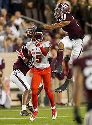 Texas A&M defensive back Derrick Tucker (4) breaks up a pass intended for New Mexico safety Michael Sewell Jr. (5) during the first quarter of an NCAA college football game on Saturday, Nov. 11, 2017, in College Station, Texas. (AP Photo/Sam Craft)