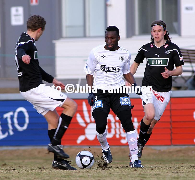 19.04.2010, Tehtaankentt?, Valkeakoski..Veikkausliiga 2010, FC Haka - FC TPS Turku..Ben Traore (Haka) v Jonatan Johansson & Mika EUR?ritalo (TPS).©Juha Tamminen.