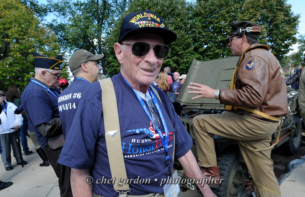 WWII Veterans and their escorts at the WWII Memorial in Washington, DC on Saturday, October 18, 2014. Seventy-five WWII Veterans from the Westchester County area toured the WWII Memorial and Arlington National Cemetery onboard the inaugural flight from Westchester County Airport in White Plains, NY. Hudson Valley Honor Flight is a chapter of the Honor Flight Network, which provides free flights for WWII Veterans and tours of the WWII Memorial constructed in their honor, and other sites in the nation's capital.  © www.chetgordon.com