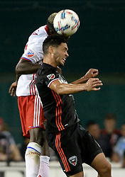 August 5, 2017 - Washington, DC, USA - 20170805 - Toronto FC defender CHRIS MAVINGA (23), left, and D.C. United midfielder LAMAR NEAGLE (13) battle for a head ball in the second half at RFK Stadium in Washington. (Credit Image: © Chuck Myers via ZUMA Wire)