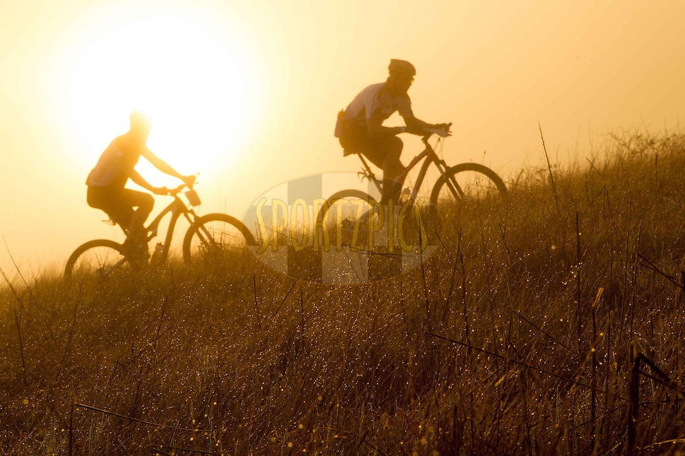 Early morning riders enjoy the cool mist at sunrise during the Prologue of the 2013 Absa Cape Epic Mountain Bike stage race held at Meerendal Wine Estate in Durbanville outside Cape Town, South Africa on the 17 March 2013..Photo by Greg Beadle/Cape Epic/SPORTZPICS