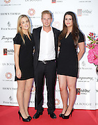 27/9/14***NO REPRO FEE*** Pictured is Lee Roberts Robert Tengren and Kate O'Connell as Dublin's ladies turn out for a fashionable Cocktail Evening in aid of the Caroline Foundation Pic: Marc O'Sullivan  Friday 26th September: Last night saw a slice of high-end NY style hit Dublin, arriving at The Four Seasons.  Stylish ladies turned out in force to support the event and to mark the start of Breast Cancer Awareness month. The fundraiser, which was a sell-out was the brainchild of Paula McClean a breast cancer survivor and tireless fundraiser. Combining her love of fashion and a good party, the first Cocktail Club Event was born. With a great night of style, fun and raising a lot of money for cancer research, it is no wonder it was a sell- out.  The lucky ladies were treated to a special fashion Show by Brown Thomas who show cased their designers in a salon style. The show featured a selection of key looks mirroring trends from the international runways. The mood for AW14 is easy, elegant, casual and chic. New labels to love include Jenny Packham, Valentino, Osman, Brunello Cucinelli and Moschino. Curated by the affable Michelle Curtain, the clothes were a show-stopper. In keeping with the era of the collection, the evening had a distinctive New York retro theme. Signature 'Original' cocktails from The Four Seasons, featuring Tanqueray London Dry Gin and Ketel-One with the trademark Copper Kettle serve, were the order of the day with eclectic tunes from club DJ Dom to keep the party going. All the lucky ladies went home with a luxury La Bougie Candle. The inaugural Cocktail Club in aid of the Caroline Foundation is the brainchild of Paula McClean a breast cancer survivor and tireless fundraiser. Commenting on the evening, 'Breast Cancer and the Caroline Foundation are very close to my heart and combining this with my love of fashion and a good party, we came up with the first Cocktail Club. We are looking forward to a great night of style, fun and raising a lot