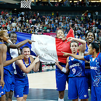 09 August 2012: Team France players celebrate showing a flag with POUR NOS GARS (meaning FOR OUR BOYS, the men team France) writing on it after the 81-64 Team France victory over Team Russia, during the women's basketball semi-finals, at the 02 Arena, in London, Great Britain.