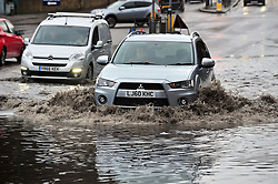&copy; Licensed to London News Pictures.01/01/2018<br /> AYLESFORD, UK.<br /> A20 London Road in Aylesford, Kent is flooded up to a foot deep in parts.<br /> Some roads in Kent have been flooded due to heavy rain today New Years Day.<br /> Photo credit: Grant Falvey/LNP