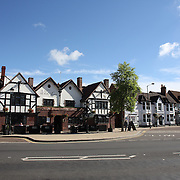 Stratford-upon-Avon town Square. Stratford-upon-Avon is a market town and civil parish in south Warwickshire, England. It lies on the River Avon. The town is a popular tourist destination owing to its status as birthplace of the playwright and poet William Shakespeare, receiving about 3 million visitors a year. The Royal Shakespeare Company resides in Stratford's Royal Shakespeare Theatre. Photo Tim Clayton