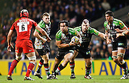Picture by Andrew Tobin/Focus Images Ltd. 07710 761829. .27/12/11. Maurie Fa'asavalu (6) of Harlequins runs with the ball past Kelly Brown (6) of Saracens during the Aviva Premiership match between Harlequins and Saracens at Twickenham Stadium, London.