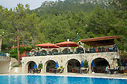 An outdoor swimming pool next to the restaurant of a hotel in Turkey