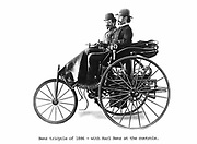 Benz tricycle of 1886 with Karl Benz (1844-1929), German engineer and car manufacturer, at the controls.