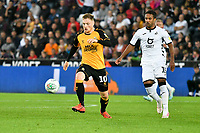 Football - 2019 / 2020 EFL Carabao (League) Cup - Second Round: Swansea City vs. Cambridge United<br /> <br /> George Maris of Cambridge United  & Ben Wilmot of Swansea City, at Liberty Stadium.<br /> <br /> COLORSPORT/WINSTON BYNORTH