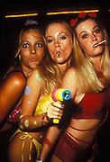 Three blonde clubbing girls sucking lollies in bikinis, one holding a bubble gun, Ibiza 1999
