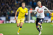 Scott Wootton of Leeds United and Bolton Wanderers defender Dean Moxey chase the ball during the The FA Cup fourth round match between Bolton Wanderers and Leeds United at the Macron Stadium, Bolton, England on 30 January 2016. Photo by Simon Brady.