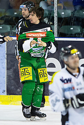 29.01.2013, Hala Tivoli, Ljubljana, SLO, EBEL, HDD Olimpija Ljubljana vs Dornbirner Eishockey Club, 4. Qualifikationsrunde, im Bild Ziga Grahut (HDD Olimpija, #11) // after the fight // during the Erste Bank Icehockey League 4th Qualification Round match between HDD Telemach Olimpija Ljubljana and Dornbirner Eishockey Club at the Hala Tivoli, Ljubljana, Slovenia on 2013/01/29. EXPA Pictures © 2013, PhotoCredit: EXPA/ Sportida/ Matic Klansek Velej..***** ATTENTION - OUT OF SLO *****