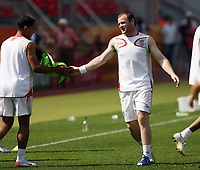 Photo: Chris Ratcliffe.<br />England Training Session. FIFA World Cup 2006. 14/06/2006.<br />Wayne Rooney in training passes the bib to Theo Walcott.