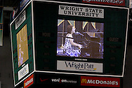 Lauren E. Davis' performance is shown on the big screens during the 43rd Semiannual Commencement at the Nutter Center, Saturday, June 12, 2010.