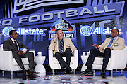 NFL Network host Fran Charles (left), Pro Football Hall of Fame member and former San Diego Chargers quarterback Dan Fouts (center), and Pro Football Hall of Fame member and former Houston Oilers quarterback Warren Moon co-host the Pro Football Hall of Fame news conference to announce the 2012 Class of Enshrinees at the media center during the week of NFL Super Bowl XLVI on Saturday, February 4, 2012 in Indianapolis, Indiana. ©Paul Anthony Spinelli