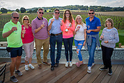 A group of visitors enjoy a glass of wine outdoors after a wine tasting session at Hush Heath Winery, Staplehurst, Kent, England, UK.  (photo by Andrew Aitchison / In pictures via Getty Images)