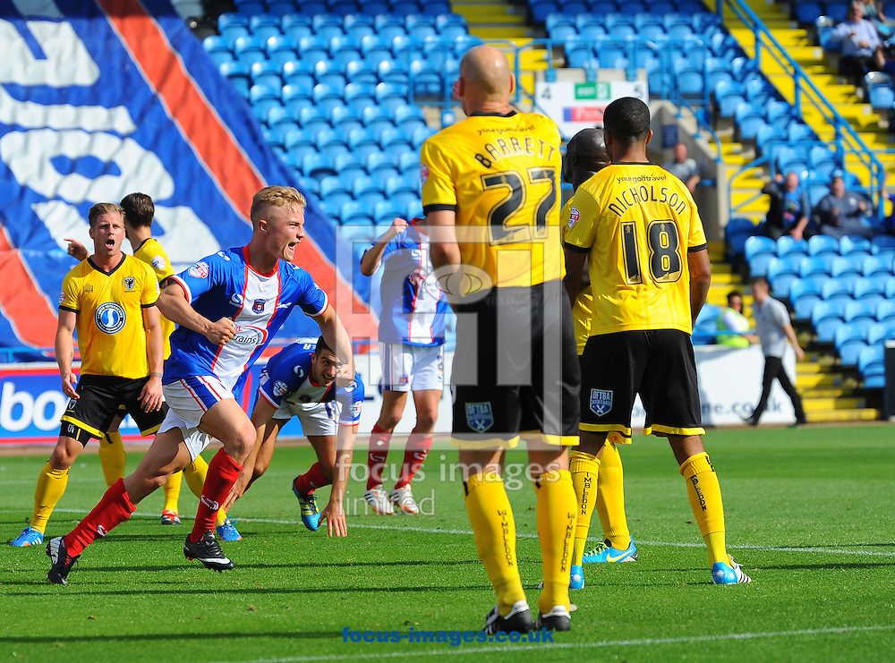Kyle Dempsey of Carlisle United (left) celebrates scoring his team's second goal during the Sky Bet League 2 match at Brunton Park, Carlisle<br /> Picture by Greg Kwasnik/Focus Images Ltd +44 7902 021456<br /> 06/09/2014