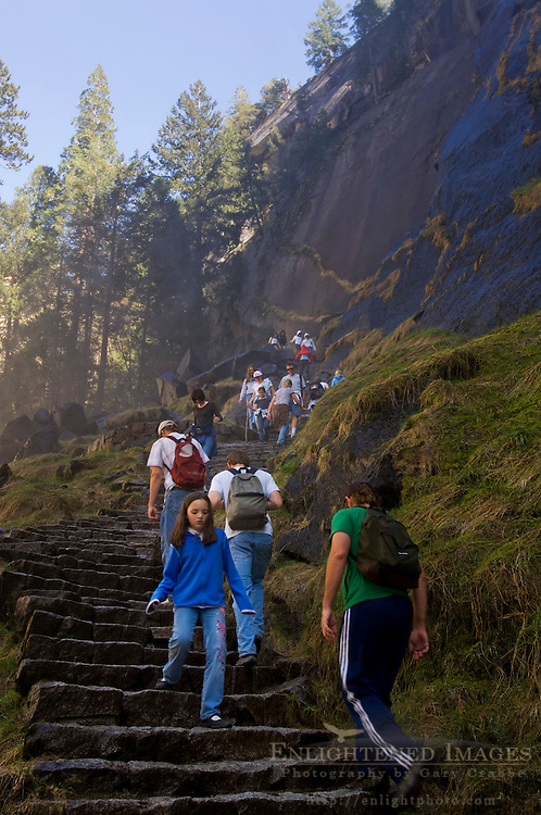 Hikers climbing on the steep rocky staircase stairs of the Mist Trail, Yosemite National Park, California