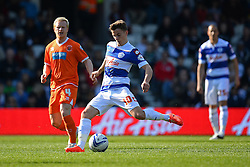 Blackpool's defender Gary MacKenzie and QPR's midfielder Tommy Carroll  - Photo mandatory by-line: Mitchell Gunn/JMP - Tel: Mobile: 07966 386802 29/03/2014 - SPORT - FOOTBALL - Loftus Road - London - Queens Park Rangers v Blackpool - Championship