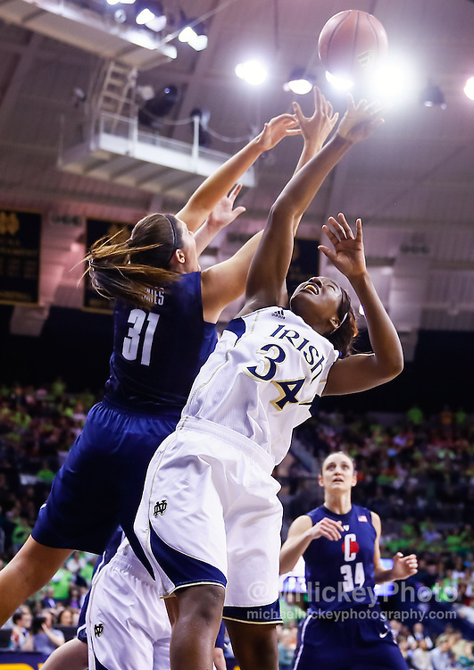 SOUTH BEND, IN - MARCH 04: Stefanie Dolson #31 of the Connecticut Huskies and Markisha Wright #34 of the Notre Dame Fighting Irish battle for the ball at Purcel Pavilion on March 4, 2013 in South Bend, Indiana. Notre Dame defeated Connecticut 96-87 in triple overtime to win the Big East regular season title. (Photo by Michael Hickey/Getty Images) *** Local Caption *** Stefanie Dolson; Markisha Wright