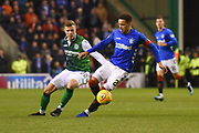 James Tavernier is tracked by Florian Kamberi during the Ladbrokes Scottish Premiership match between Hibernian and Rangers at Easter Road, Edinburgh, Scotland on 19 December 2018.