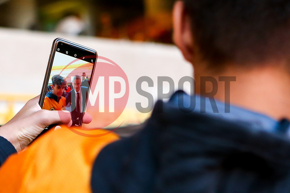 Manchester United manager Ole Gunnar Solskjaer poses for selfies ahead of the Premier League fixture against Wolverhampton Wanderers - Mandatory by-line: Robbie Stephenson/JMP - 19/08/2019 - FOOTBALL - Molineux - Wolverhampton, England - Wolverhampton Wanderers v Manchester United - Premier League