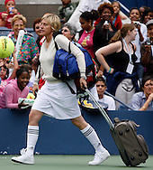 Actress and comedian Ellen DeGeneres  takes part in a charity skills competition during 'Arthur Ashe Kids Day' before the 2006 U.S. Open at the USTA National Tennis Center in New York August 26, 2006. The U.S. Open starts on August 28. .