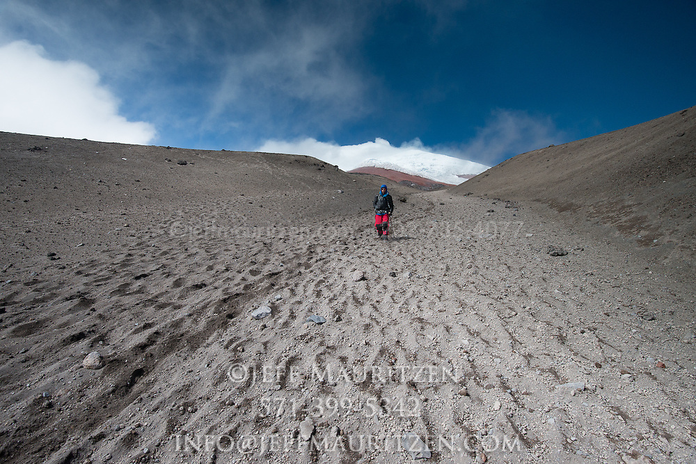 Hikers climb down Cotopaxi volcano in Ecuador, one of the highest active volcanoes in the world.