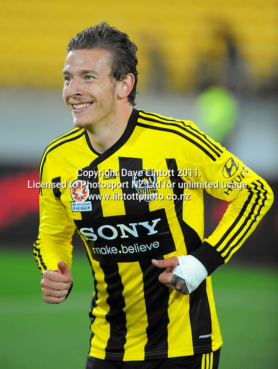 Phoenix Mirjan Pavlovic smiles after his second goal during the A-League football match between Wellington Phoenix v Newcastle Jets at Westpac Stadium, Wellington, New Zealand on Friday, 23 December 2011. Photo: Dave Lintott / lintottphoto.co.nz