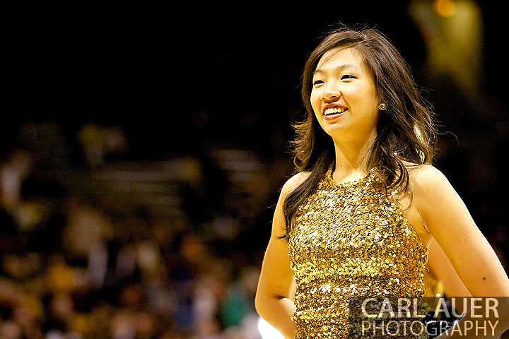 January 12th, 2013: A Colorado cheerleader waits for the Buffaloes to come onto the court for the NCAA basketball game between the UCLA Bruins and the University of Colorado Buffaloes at the Coors Events Center in Boulder CO