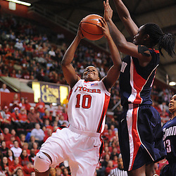 Mar 2, 2009; Piscataway, NJ, USA; Rutgers guard Epiphanny Prince (10) puts up a shot under the block attempt of Connecticut center Tina Charles (31) during the second half of Rutgers game against nationally rated #1 Connecticut at the Louis Brown Athletic Center.  Connecticut won 69-59 to finish their regular season a perfect 30-0.