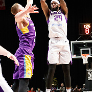 Reno Bighorns Forward JAKARR SAMPSON (29) shoots over South Bay Lakers Forward TRAVIS WEAR (21) during the Western Conference Semi-Final NBA G-League Basketball game between the Reno Bighorns and the South Bay Lakers at the Reno Events Center in Reno, Nevada.