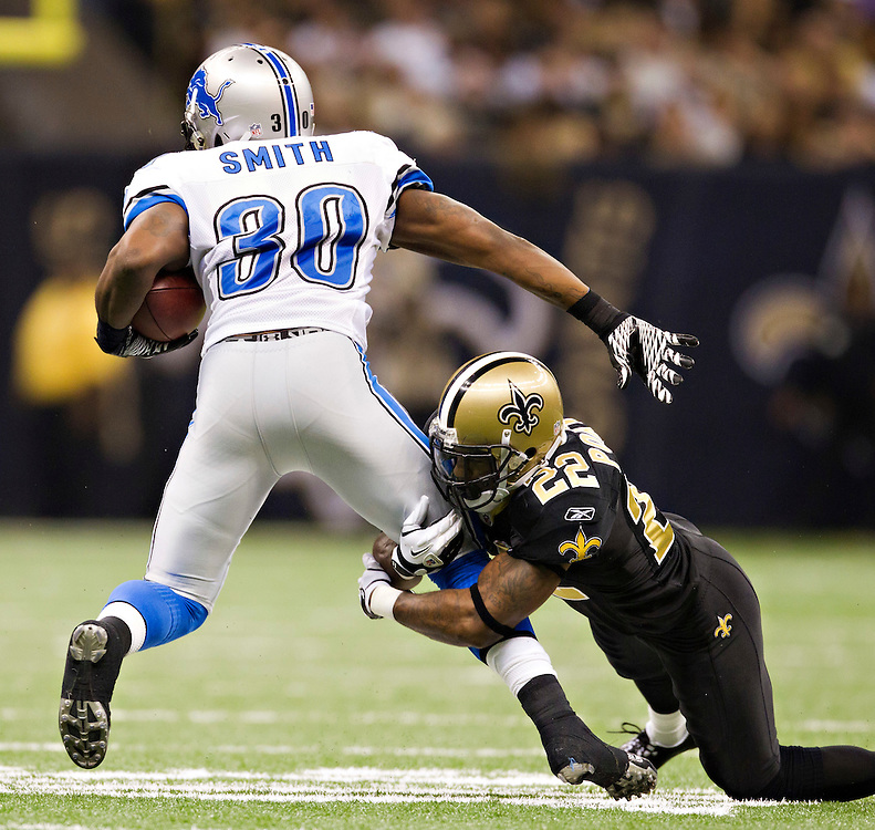 NEW ORLEANS, LA - DECEMBER 4:   Tracy Porter #22 of the New Orleans Saints tackles Kevin Smith #30 of the Detroit Lions at Mercedes-Benz Superdome on December 4, 2011 in New Orleans, Louisiana.  The Saints defeated the Lions 31-17.  (Photo by Wesley Hitt/Getty Images) *** Local Caption *** Tracy Porter; Kevin Smith
