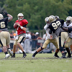 Aug 3, 2013; Metairie, LA, USA; New Orleans Saints quarterback Luke McCown (7) looks to pass during a scrimmage at the team training facility. Mandatory Credit: Derick E. Hingle-USA TODAY Sports