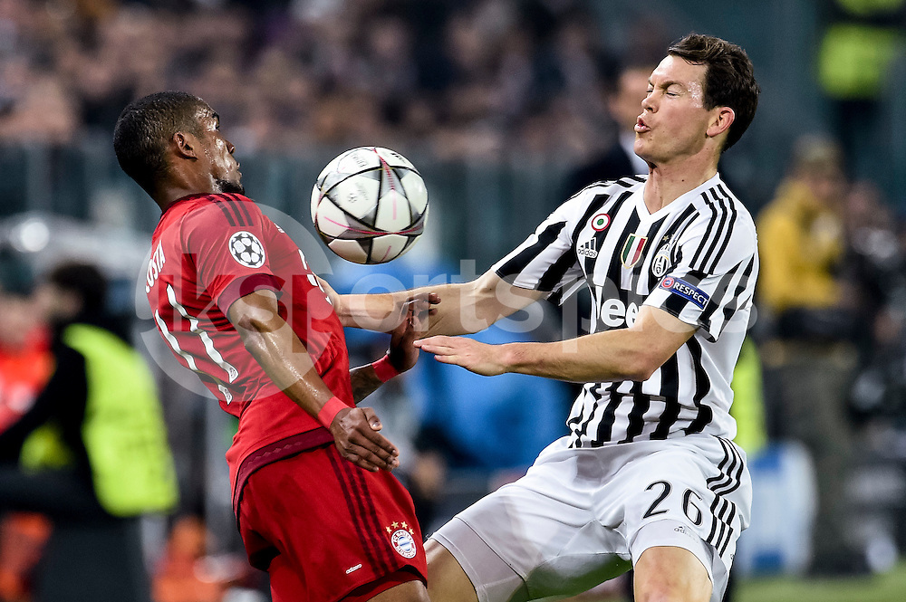 Douglas Costa of Bayern Munich is challenged by Stephen Lichtsteiner  of Juventus  during the UEFA Champions League match Round of 16 between Juventus and Bayern Munich at the Juventus Stadium, Turin, Italy on 23 February 2016. Photo by Giuseppe Maffia.