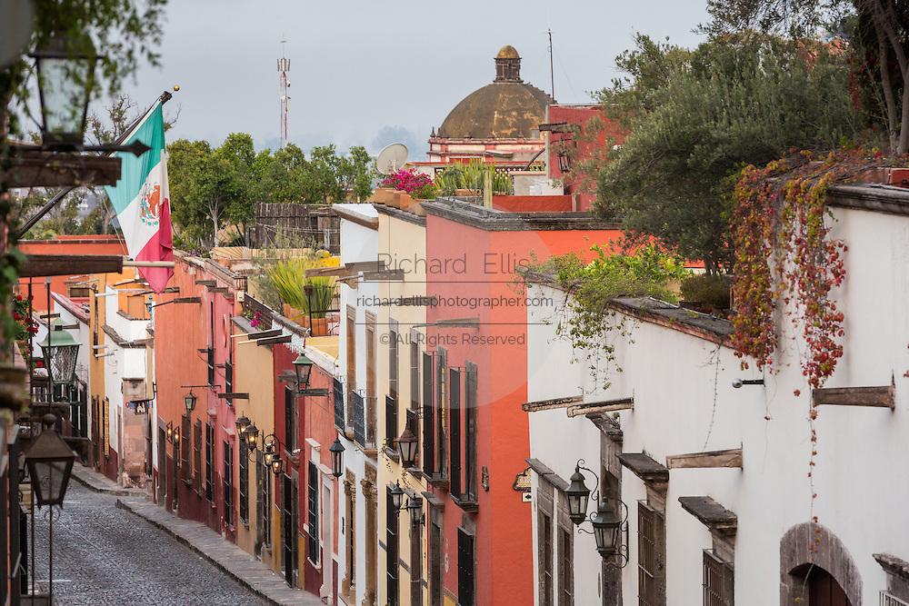 Spanish colonial style homes along the cobblestone Correo street in the historic center of San Miguel de Allende, Mexico.