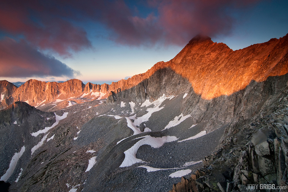 Pierre lakes cirque and Capitol Peak 14,130ft illuminated at sunrise, Elk Range, Colorado.
