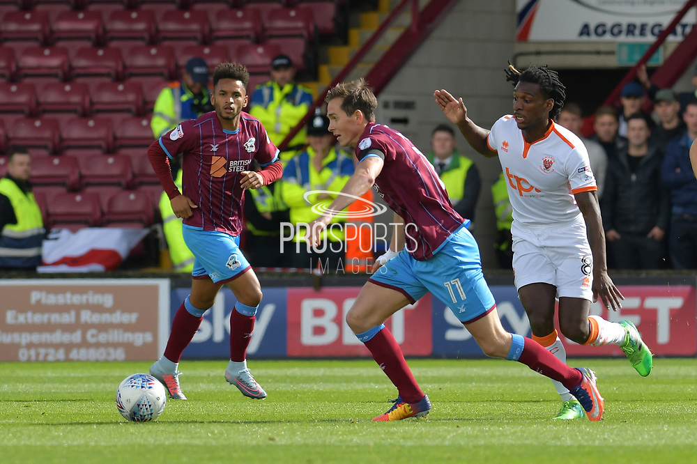 Scunthorpe United midfielder Josh Morris (11) and Blackpool FC midfielder Sessi D'Almeida (8) during the EFL Sky Bet League 1 match between Scunthorpe United and Blackpool at Glanford Park, Scunthorpe, England on 9 September 2017. Photo by Ian Lyall.